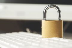 Lock on keyboard. Lock on the white keyboard on desk royalty free stock images