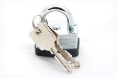 Lock and Keys. A macro shot of a lock and keys over a white background Royalty Free Stock Photography