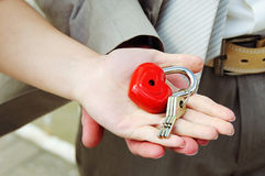 Lock with keys in hands of groom and bride Royalty Free Stock Photography