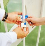 Lock with keys in hands of groom and  bride Stock Photo