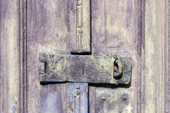 Lock and latch in closed door Stock Images