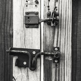 Lock and Latch on a Wooden Gate Royalty Free Stock Photos