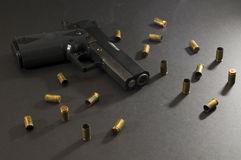 Lock and load. Picture of a smoking gun Royalty Free Stock Photos
