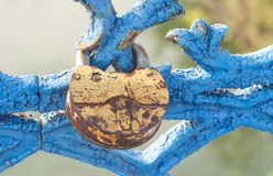 `The lock of love` on the blue railings of the bridge royalty free stock photography