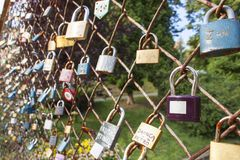 Lock of love. Desire of eternal love, locked lock on the bridge. Symbol of mutual love. Wishes for Valentine's Day. Instead of text. Old lock hung on a wire Stock Photography