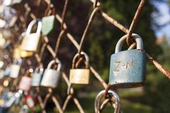 Lock of love. Desire of eternal love, locked lock on the bridge. Symbol of mutual love. Wishes for Valentine's Day, instead of text. Old lock hung on a wire Stock Photo