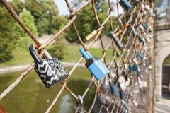 Lock of love. Desire of eternal love, locked lock on the bridge. Symbol of mutual love. Wishes for Valentine's Day, instead of text. Old lock hung on a wire Stock Image