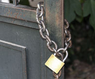 Lock on a metal chain Stock Image