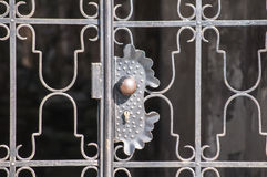 Lock on metal patio door grid Stock Photography