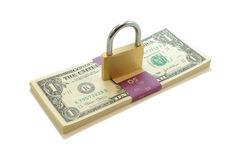 Lock on Money. Golden Lock on top of a strapped stack of one dollar bills at an angle showing security of money and finances stock photos