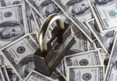 The lock and money. The lock which is located on money stock images