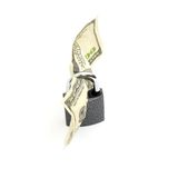 Lock and money isolated Stock Photo
