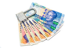 Lock and money, isolated on the white Royalty Free Stock Images