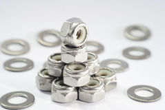 Lock nut and washer. Group of lock nut and washer on white background Stock Photography