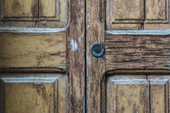 Lock on old cracked wood door Royalty Free Stock Photo
