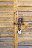 The Lock. Old garage door with a lock on it. May be used for any kind of design Stock Photo