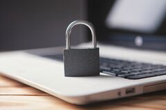 Free Lock On Laptop As Computer Protection And Cyber Safety Stock Images - 215014894
