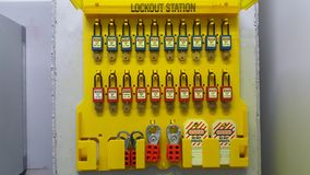 Lock out & Tag out , Lockout station, machine - specific lockout devices. And safety sign stock photography