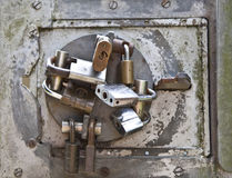 Lock Panel. Large circular lock hasp with several different padlocks on it Royalty Free Stock Images