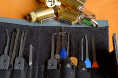 Lock picking tools. A range of lock picking tools together with lock barrels for practice Royalty Free Stock Images