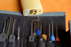 Lock picking tools. A range of lock picking tools together with a padlock for practice Stock Images