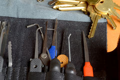 Lock picking tools. A range of lock picking tools together with a set of keys for practice Royalty Free Stock Photography