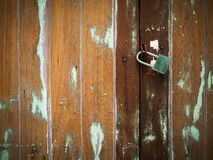 Lock on Plank Cracked Wood Door Stock Photo