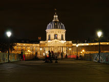 A lock less Pont Des Arts et place de l'institut Paris France at night Stock Images