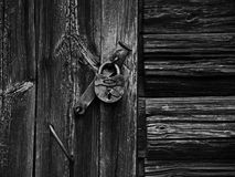 Lock on the rotten wooden wall. Shot in Russia Kostroma fall and summer 2015 stock photography