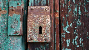 Lock. Rusty blue old lock on wooden doors Stock Images