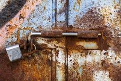 Lock on rusty iron door Royalty Free Stock Photography