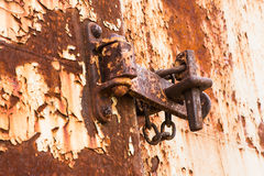 Lock on rusty iron door Stock Photos