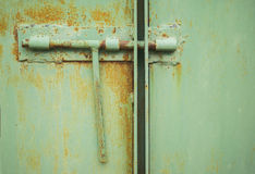 Lock on rusty iron door. For your commercial and Royalty Free Stock Images