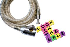 Lock In The Sale Concept. A bicycle lock with the phrase, Lock In The Sale, for motivation stock image