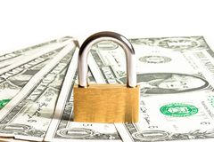 Lock security on dollars banknotes Royalty Free Stock Images