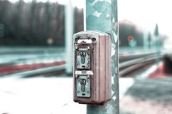 Lock of the signal system next to the train tracks stock photos