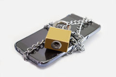 Lock smart phone. By chain stock photos