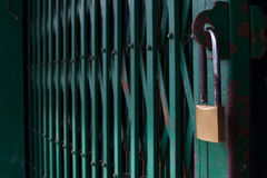 Lock Steel Door. Rust Lock and Green Steel Door Stock Photography