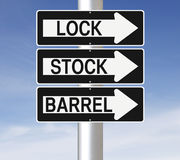 Lock, Stock and Barrel. Conceptual one way signs indicating Lock, Stock, and Barrel Stock Photos