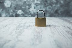Lock on table. Lock on the wooden table on gray background royalty free stock images