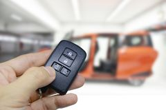 Lock and Unlock and open the CAR door slide with Remote keys. Lock and Unlock CAR with Remote keys for security stock photography