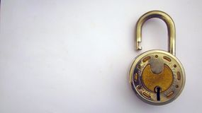 Lock Unlocked on White Background. Captured lock in unlocked position on white background to show security hacked or unlocked Stock Images
