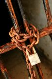 Lock up. Chains with lock closing a gate Royalty Free Stock Image