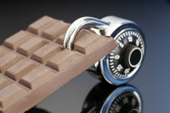 Lock up your Chocolate. Chocolate bar shoot with a padlock securing the chocolate royalty free stock image