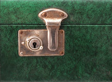 Lock on a vintage suitcase. Lock on a green vintage suitcase stock image