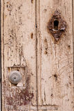 Lock on weathered wood door Royalty Free Stock Images