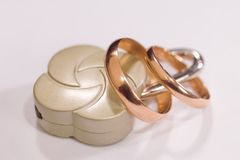 Lock and wedding rings Stock Photos