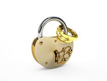 The lock and wedding rings. On white Stock Images