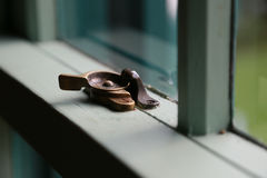 Lock of the window. Lock lever of the window of the room Royalty Free Stock Photography