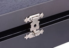 The lock of a wooden casket Stock Images